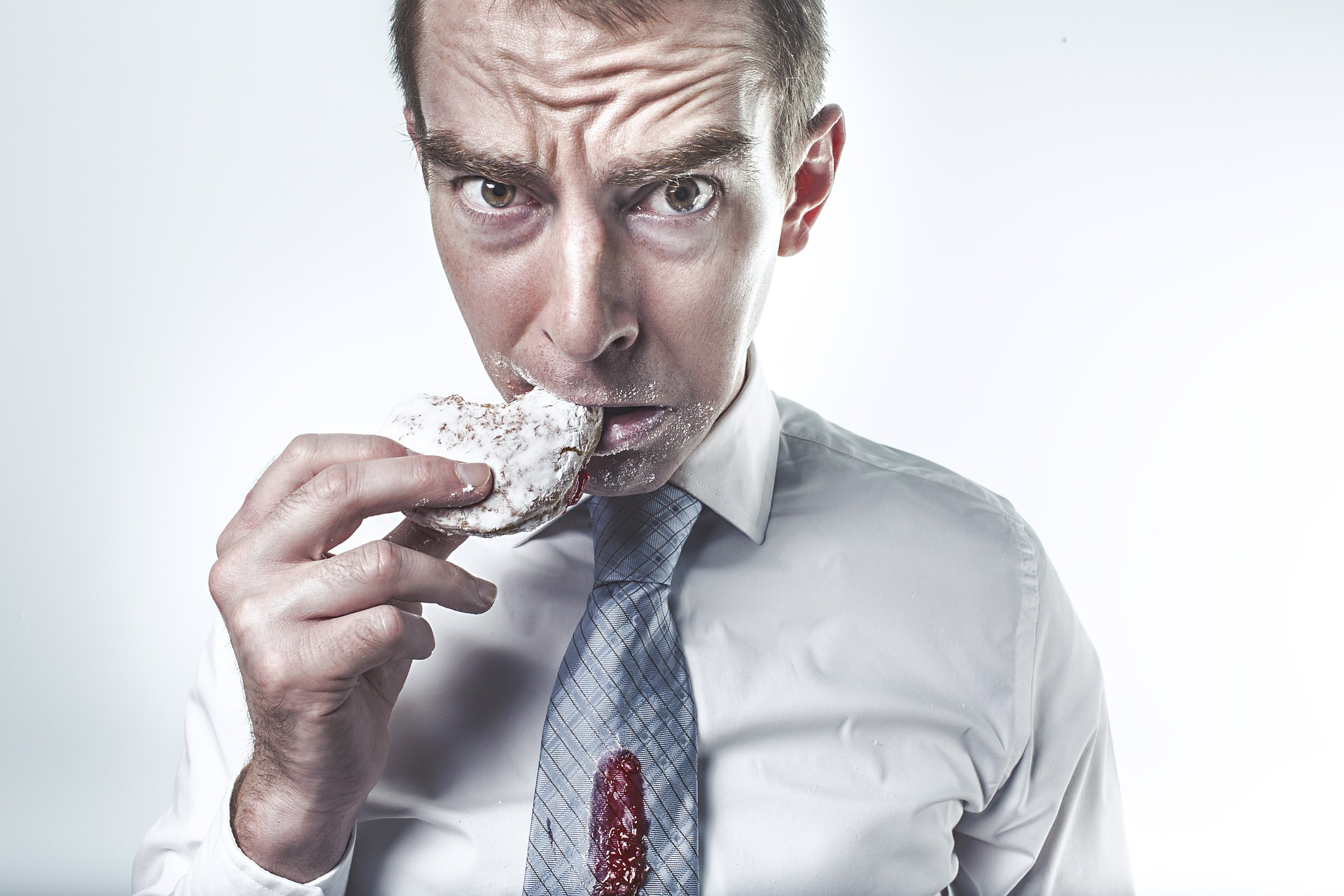 man eating a jelly donut