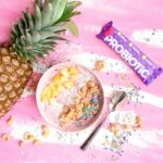 pineapple, a probiotic bar and a bowl of fruit yoghurt